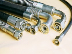 Special hose assemblies for hydraulic suppo